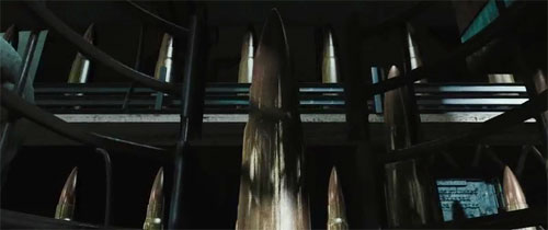 Frame from the Lord of War opening title showing a close-up of a bullet