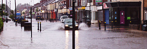 A car driving through flooded streets